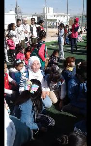 Amnah Aleid with UNICEF kids
