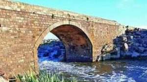 One of the old bridges of Daraa Governorate runs under it a valley